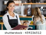 portrait of smiling waitress... | Shutterstock . vector #459236512