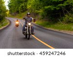 Two Friends Riding Motorcycles...