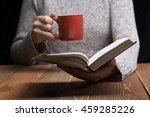 young woman reading a book and... | Shutterstock . vector #459285226