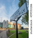 Small photo of MANCHESTER - MAY 22: Sir Alex Ferguson way sign on outdoor way to Old Trafford stadium in Manchester city, England, on May 22, 2016.