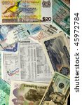 Published foreign exchange rates surrounded by a selection of various worldwide currencies - stock photo