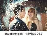 Young Couple Standing Under A...