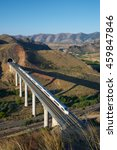 Small photo of view of a high-speed train crossing a viaduct in Purroy, Zaragoza, Aragon, Spain. AVE Madrid Barcelona.