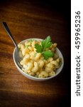 Small photo of Delicious macaroni and cheddar cheese with parsley sprig