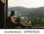 hipster man sitting on porch of ... | Shutterstock . vector #459969025