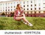 blonde enjoying music with... | Shutterstock . vector #459979156