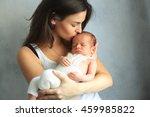 mother kissing newborn son at... | Shutterstock . vector #459985822
