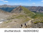 Small photo of Summer Mountain Hiking Trail - Hikers on a rocky and steep trail at base of Grays Peak in Front Range of Colorado Rockies, USA.