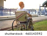 young guy alone on wheelchair... | Shutterstock . vector #460143592
