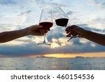 women's hands with a glass of...   Shutterstock . vector #460154536