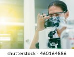 close up of female scientist... | Shutterstock . vector #460164886