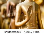 hands of buddha statue in... | Shutterstock . vector #460177486