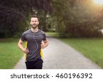 Fit bearded young man jogging...