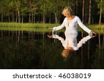 Woman Swimming In Dark Forest...
