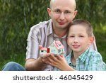 father and son keeping in their ... | Shutterstock . vector #46045429