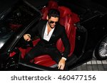 men in luxury car. night life. | Shutterstock . vector #460477156