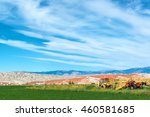Landscape featuring tractors and an airplane boneyard in Greybull, Wyoming