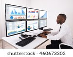 young businessman analyzing... | Shutterstock . vector #460673302