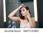 young woman checking wrinkles... | Shutterstock . vector #460713382