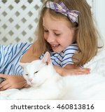 Little Girl Lying With Cat On...