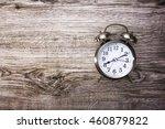 retro alarm clock on wooden... | Shutterstock . vector #460879822