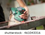 hand of young man sanding small ... | Shutterstock . vector #461043316