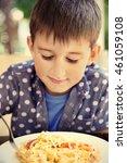 cute boy eating spaghetti in... | Shutterstock . vector #461059108