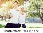 people practicing thai chi in... | Shutterstock . vector #461114572