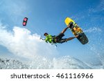 a kite surfer rides the waves  | Shutterstock . vector #461116966