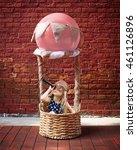 a little girl is sitting in a...   Shutterstock . vector #461126896