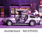 Small photo of Timesquare, New York City - USA - JUNE 26, 2016: DMC De Lorean Back to the future car parking for show under the ambience light at Fifth Avenue Timesquare, New York City - USA