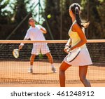 Young Couple Playing A Tennis...