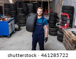 happy mechanic carrying a tire... | Shutterstock . vector #461285722