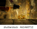barman pouring whiskey in front ... | Shutterstock . vector #461460712