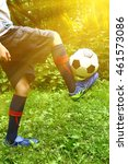 boys legs in football boots and ... | Shutterstock . vector #461573086