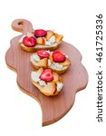 Small photo of Bruschetta with peach, strawberry and adygei cheese on a board.