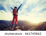 cheering young woman backpacker ... | Shutterstock . vector #461745862