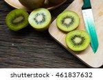 kiwi fruit slices on wooden... | Shutterstock . vector #461837632