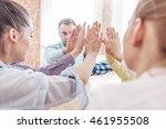 coworkers doing high five... | Shutterstock . vector #461955508