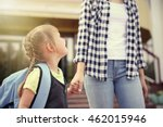 Small photo of Mother taking daughter to school
