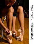 An Elegant Ballet Dancer Tying...