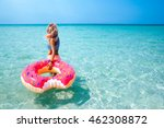 Woman Swimming With Inflatable...