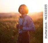 boy stands in a field in retro... | Shutterstock . vector #462333355