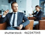 young businessman sitting with... | Shutterstock . vector #462347545