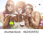 girls blowing some confetti... | Shutterstock . vector #462424552