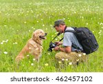 Photographer And Dog Golden...