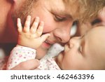 a happy father is playing with... | Shutterstock . vector #462463396