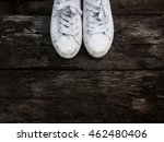 White Sneaker Shoes On Dark...