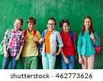 happy pupils standing by the... | Shutterstock . vector #462773626