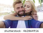 couple taking close picture  | Shutterstock . vector #462864916